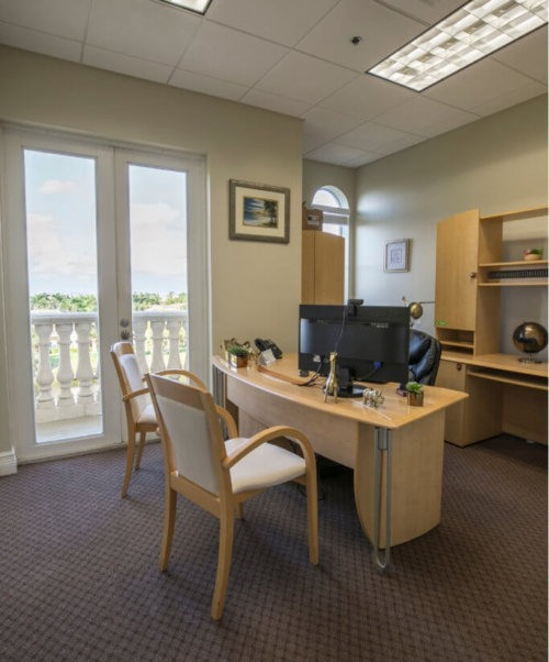 The interior of an executive office space in Boca Raton with a patio and nice view.