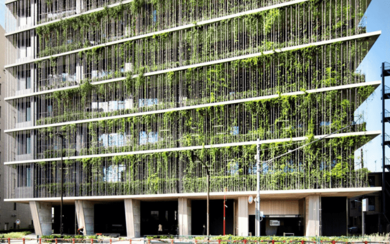 beautiful building with green hanging plants on the facade