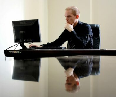 Man facing computer trying to make a decision
