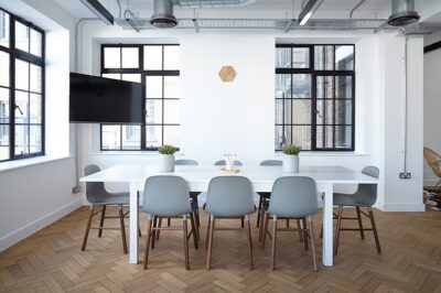 A small office with an allocated area for meetings.