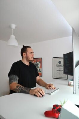 A modern employee working from a standing desk.